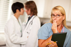 foto of office romance  - Alarmed Medical Woman Witnesses Her Colleagues Inner Office Romance Display - JPG