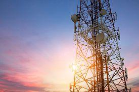 stock photo of network  - Satellite dish telecom network at sunset communication technology network - JPG
