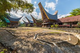 foto of barn house  - Row of traditional houses and rice barns facing each other in a tipical traditional village of Tana Toraja South Sulawesi Indonesia - JPG