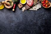 Raw beef steak cooking and ingredients. Meat piece, red wine, herbs and spices. Top view with copy s poster