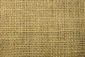Fondo con textura de una tela de arpillera marrón arena