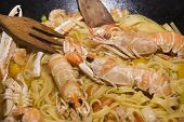 picture of norway lobster  - Pan of Italian pasta with seafood and cooked Norway lobsters - JPG