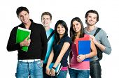 stock photo of united we stand  - Group of happy young teenager students standing and smiling with books and bags isolated on white background - JPG