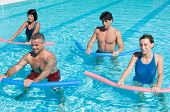 Healthy group of people exercising with aqua tube in a swimming pool