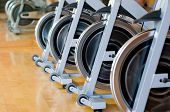 Row of wheels in a modern gym