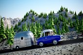 picture of travel trailer  - A cartoon Image of a couple driving in the deset towing a camper trailer - JPG