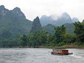 Small Boat On The Li Jiang River, Guilin, China