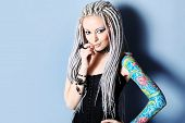 picture of dreadlock  - Portrait of a stylish young woman with white dreadlocks - JPG