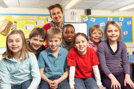 picture of school child  - School Children In Classroom With Teacher - JPG