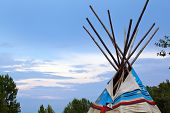 foto of wigwams  - Wooden wigwam against the colorful blue sky - JPG