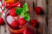 Raspberry Mojito Lemonade With Lime And Fresh Mint In Glass On Wooden Background poster