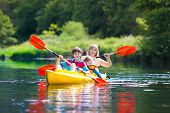 Child With Paddle On Kayak. Summer Camp For Kids. Kayaking And Canoeing With Family. Children On Can poster