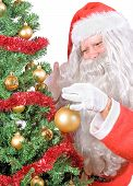Santa decorate the Christmas tree