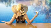 Lifestyle Asian Summer Vacation Concept,women In Swimsuit Relax With Cocktails On The Pool,young Sex poster