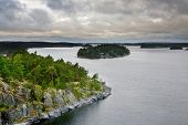Small Stone Islands In Swedish Fiord At Sunset