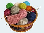 A Basket Of Yarn. Basket, Which Is Colored Yarn. poster