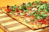 Cheese, banana, ham, onion and arugula Pizza