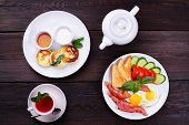 Постер, плакат: Breakfast Concept European Morning Meals Fried Eggs With Bacon And Toasts Cottage Cheese Pancakes