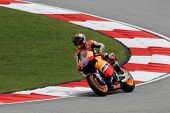 SEPANG, MALAYSIA - OCTOBER 22: 2011 MotoGP champion Casey Stoner competes during qualifying session