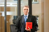 foto of court room  - German Lawyer with civil law code in a court room - JPG