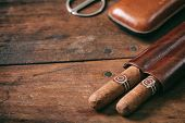 Cigars In A Leather Case On Wooden Background, Copy Space poster