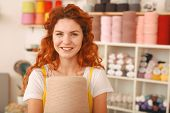 Bright Idea. Beaming Creative Red-haired Girl Having A Very Bright Idea Of Knitting Oversize Bright  poster