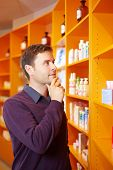Man Buying Medicine In Pharmacy