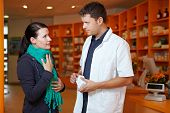 Woman With Sore Throat In Pharmacy