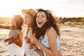 Image of three joyous multiethnic girls 20s in stylish clothing laughing and enjoying summertime dur poster