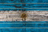 National Flag  Of Argentina On A Wooden Wall Background. The Concept Of National Pride And A Symbol  poster