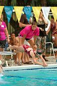 Young Girl Dives Into Pool At Swim Meet