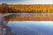 Autumn Lake Reflections. Vibrant Fall Colors Reflected In The Northern Michigan Monocle Lake At The  poster