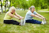 Senior ladies enhancing body flexibility by stretching