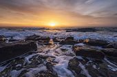 The Stunning Seascape With The Colorful Sky And Water Foam At The Rocky Coastline Of The Black Sea poster