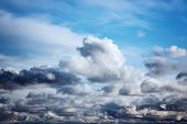 Cumulus White And Gray Clouds On A Blue Sky. Beautiful Dreamy Scene Of Air Clouds On Blue Sky Backgr poster