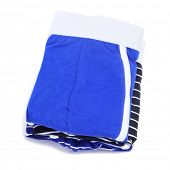 stock photo of boxer briefs  - a pile of folded boxer briefs of different colors on a white background - JPG