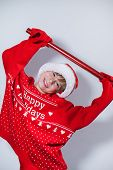 Charming Boy Wearing Santas Hat In Red Sweater poster