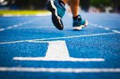 Number One On The Start Of A Running Track .blue Treadmill With Different Numbers And White Lines.se poster