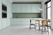 Green Kitchen Interior With Round Table poster