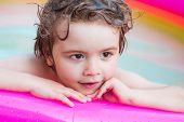Summer Holidays And Vacation Concept. Little Child Boy Having Fun In The Pool. Little Girl Having Fu poster