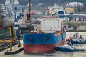 Seaport - Merchant Vessel Is Moored At The Transshipment Quay poster