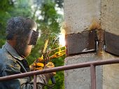 pic of tig  - The welder welds a metal plate of a pile - JPG