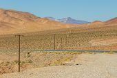 American Wilderness, An Empty State Road. Around The Mountain, Nevada, Usa. poster