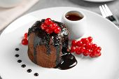 Delicious Warm Chocolate Lava Cake With Berries On Plate, Closeup poster