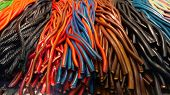 Colorful Sugar Cords And Liquorice Cords In The Display For Sale poster