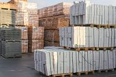 Construction Materials. Building Materials For Construction Of Residential Complex. Pile Of White Br poster