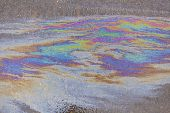 Spilled fuel. A beautiful multi-colored spot. Gasoline stains on the surface. Bright acid colors. Ab poster