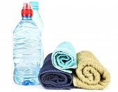 Towels and water in bottle on white