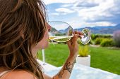 A Caucasian Woman Close Up Selective Focus As She Drinking A Glass Of White Wine. Outdoor In Restaur poster