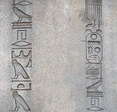 Hieroglyphs on the ancient granite egyptian obelisk. Mock up template. Copy space for text poster